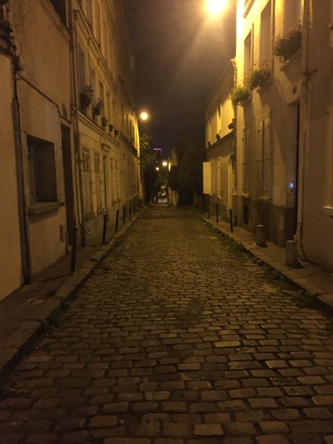 a-long-dark-alley-in-paris